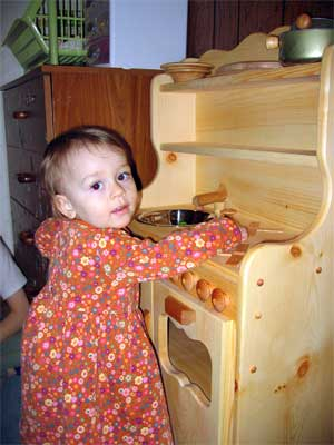 madeline and her play kitchen